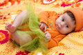Cute little girl in orange clothes Stock Images