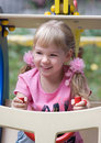 Cute little girl on outdoor playground. Royalty Free Stock Photos