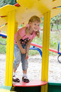 Cute little girl on outdoor playground. Royalty Free Stock Photography