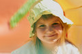 Cute little girl outdoors in a hat Stock Photography