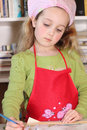 Cute Little Girl Painting Thoughtfully Royalty Free Stock Image