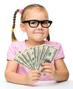 Cute little girl with paper money - dollars Royalty Free Stock Photos