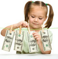 Cute little girl with paper money - dollars Stock Photography