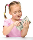 Cute little girl with paper money - dollars Stock Photos