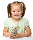 Cute little girl with paper money - dollars Stock Photo