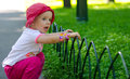 Cute little girl in park outdoor Royalty Free Stock Photo