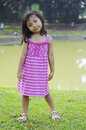 Cute little girl on the park in summer time Royalty Free Stock Photography
