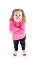 Cute little girl in pink with arms crossed isolated on a white background Stock Photo