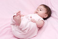 Cute little girl in pink dress bed Stock Photos