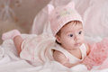 Cute little girl in pink dress bed Stock Photo