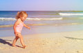Cute little girl play with water on beach Royalty Free Stock Photo