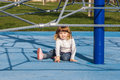 Cute little girl on playground Stock Photo