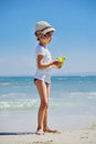 Cute little girl playing on the beach Royalty Free Stock Photo