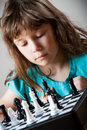 Cute little girl playing chess Royalty Free Stock Photo