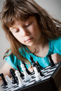 Cute little girl playing chess Stock Image