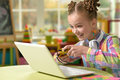 Cute little girl playing computer games Royalty Free Stock Photo