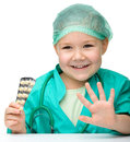 Cute little girl is playing doctor Royalty Free Stock Photos