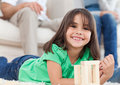 Cute little girl playing with dominoes Royalty Free Stock Images