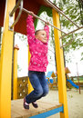 Cute little girl is playing in playground Royalty Free Stock Photo