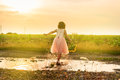 Cute little girl playing in puddle Royalty Free Stock Photo