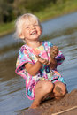 Cute little girl playing in water Royalty Free Stock Photography