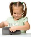 Cute little girl plays with money Royalty Free Stock Photo