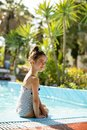Cute little girl on the poolside Royalty Free Stock Photo