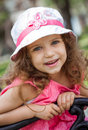 Cute little girl portrait of smiling in a park close up of beautiful child outdoors Royalty Free Stock Images