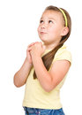 Cute little girl is praying isolated over white Royalty Free Stock Image