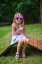 Cute little girl in purple happy birthday glasses smiling park Royalty Free Stock Photography