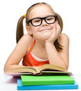Cute little girl is reading book Royalty Free Stock Photos