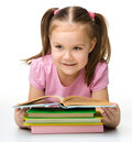 Cute little girl reads a book Stock Photography