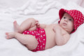 Cute little girl in red dress bed Royalty Free Stock Images