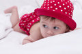 Cute little girl in red dress bed Stock Photography