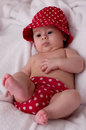 Cute little girl in red dress bed Royalty Free Stock Photography