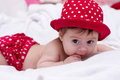 Cute little girl in red dress bed Stock Image