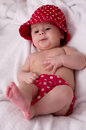 Cute little girl in red dress bed Royalty Free Stock Photo