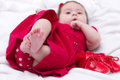 Cute little girl in red dress with shoes Stock Image