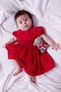 Cute little girl in red dress with teddy bear Royalty Free Stock Photography