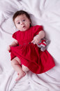 Cute little girl in red dress with teddy bear Stock Photo