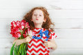 Cute little girl with red tulips on celebrating 4th july. Indepe