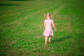 Cute little girl running at grass meadow Royalty Free Stock Photo