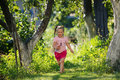 Cute little girl running with a scoop-net Royalty Free Stock Photo