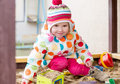 Cute little girl in a sandbox cold weather Royalty Free Stock Image