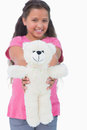 Cute little girl showing her teddy bear to camera in white background Royalty Free Stock Photography