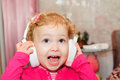 Cute little girl singing in headphones Royalty Free Stock Images