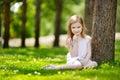 Cute little girl sitting on a clover field