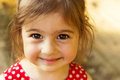 Cute little girl smiling in  summer day outdoors Royalty Free Stock Photo