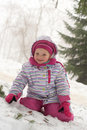 Cute little girl on the snow Royalty Free Stock Photos