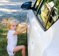 Cute Little girl standing by the car. Wanaka, New Zealand Royalty Free Stock Photo